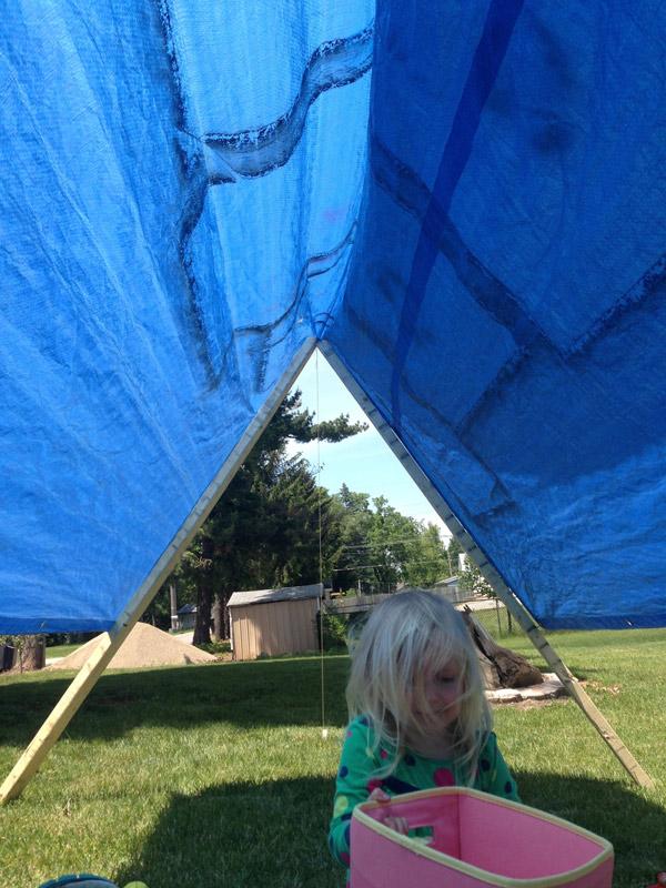 simple tarp tent provides shade
