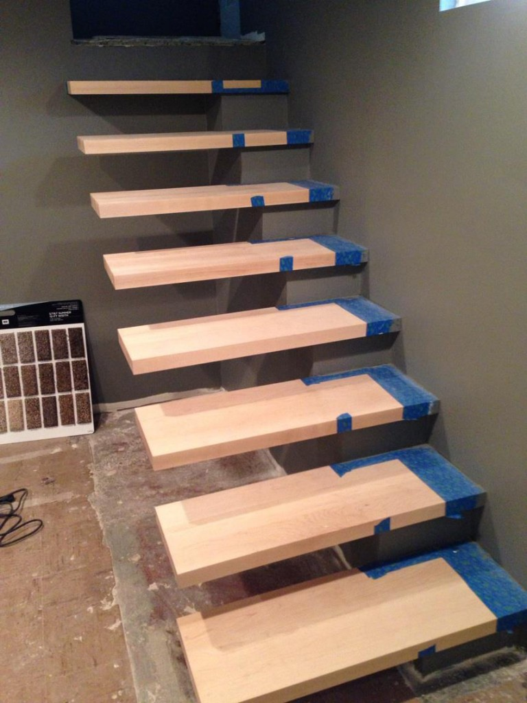 The walls get finishing touches, and the base of the floating stairs gets painted as well.