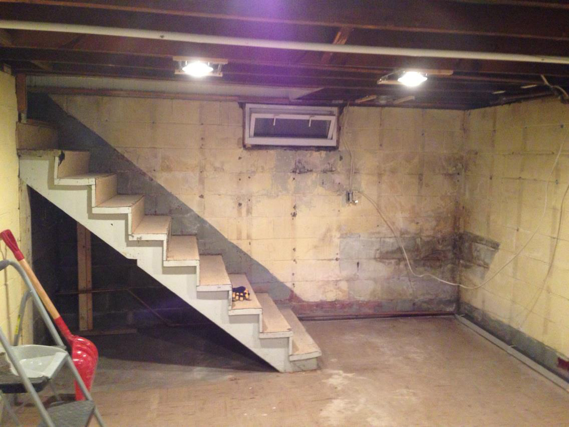 Gutted basement how to finish a basement handy father for How to build floating walls in basement