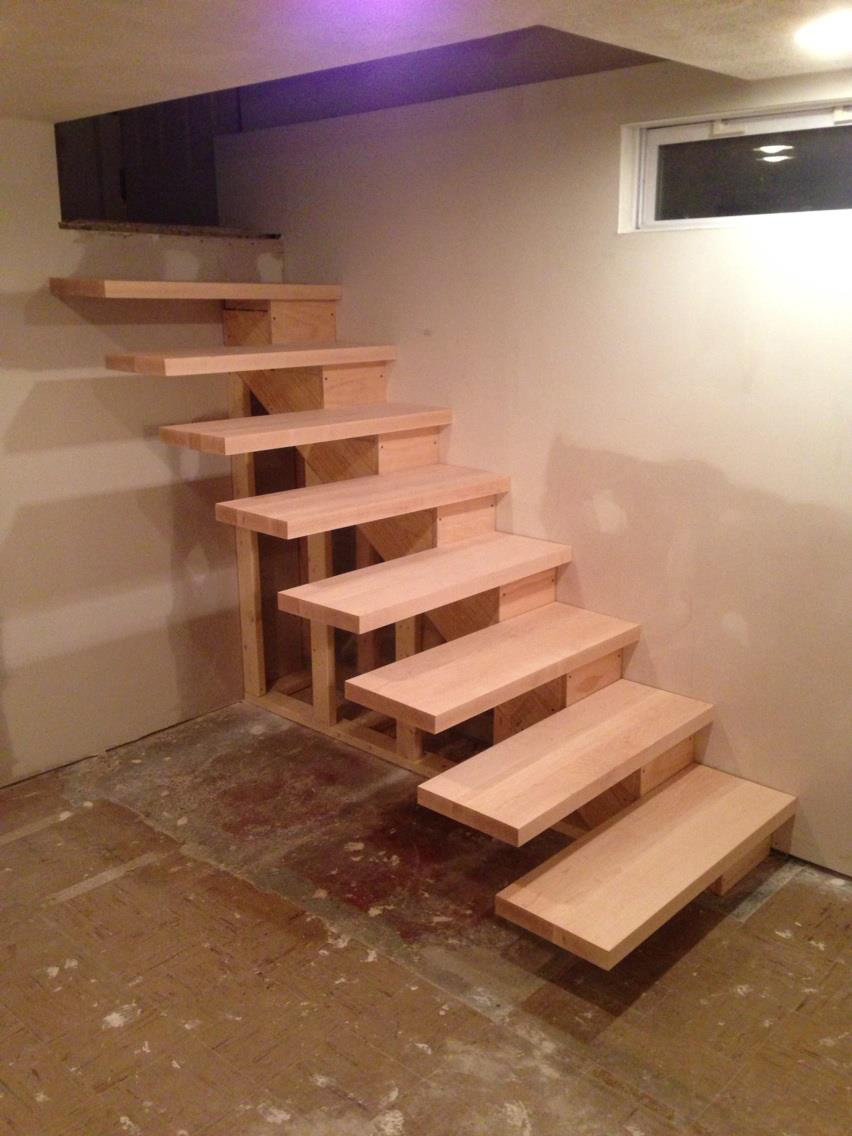 Installed floating stairs handy father for Steps to building a new home