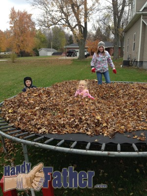 fun on the trampoline covered with fallen leaves