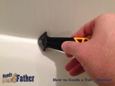 How-to caulk your bathtub - Push caulking tool into corner and pull the bead of caulk cleaning excess often.