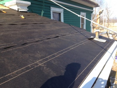 tar paper and drip edge protect the roof from a winter storm